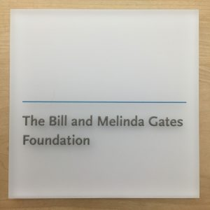 Architectural signage: Raised text, first surface print